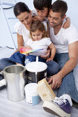 Family chosing colours to paint a bedroom — Stock Photo