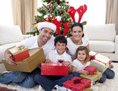 Happy family celebrating Christmas at home — Stock Photo