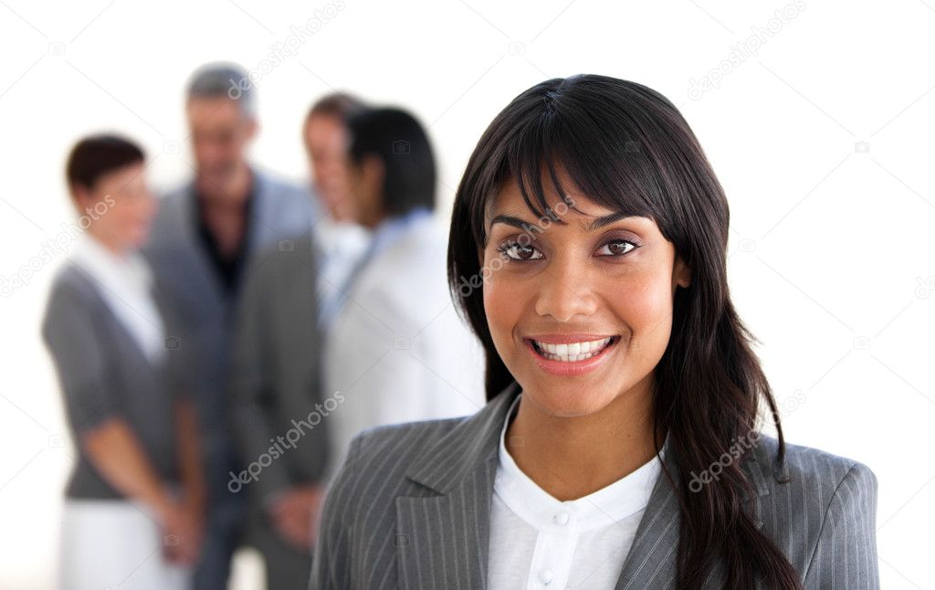 Focus on a smiling manager with her team in the background — Stock Photo #10290074