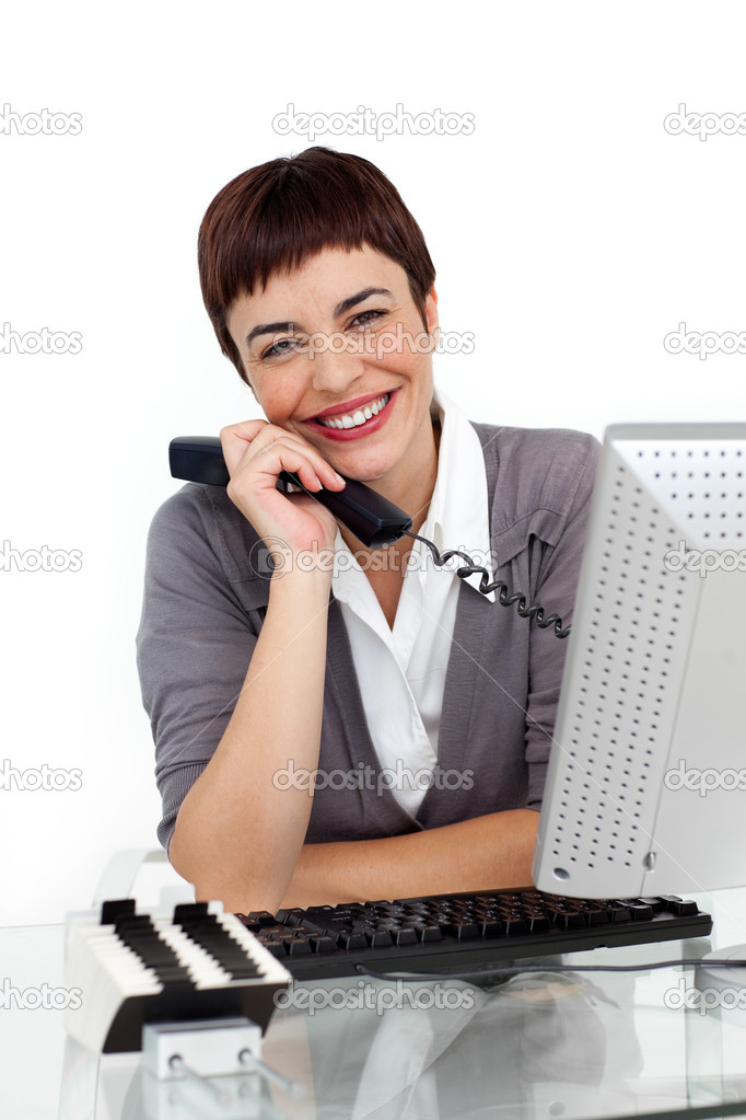 Enthusiastic businesswoman holding a telephone and smiling at the camera — Stock Photo #10290363