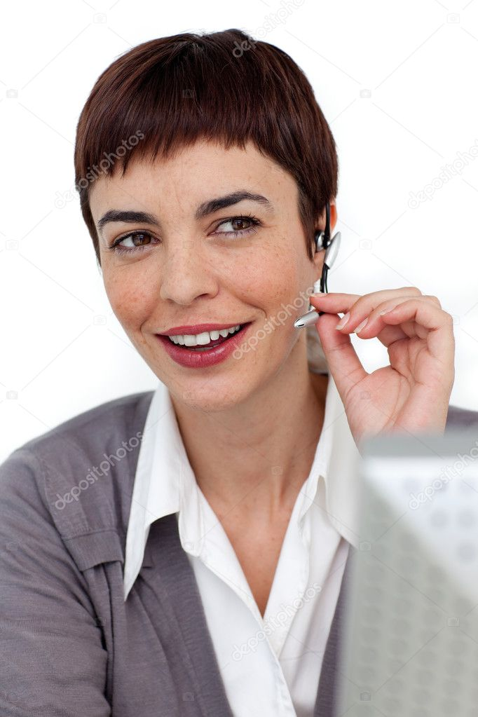 Assertive businesswoman with headset on against a white background — Stock Photo #10290369