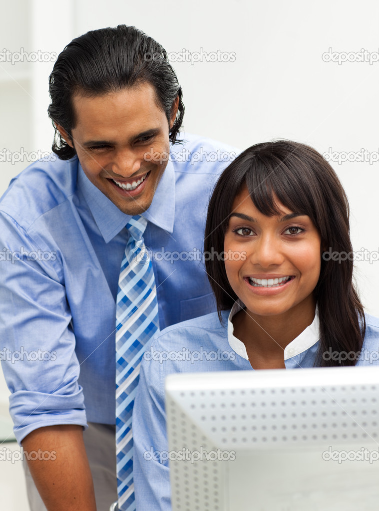 Smiling businessman helping his colleague in the office — Stock Photo #10290478