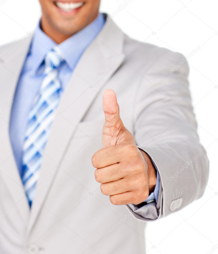 Close-up of a businessman with thumb up celebrating a victory against a white background — Stock Photo #10290596
