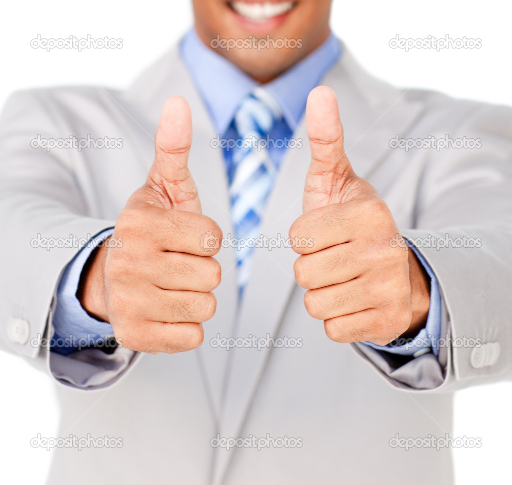 Close-up of a businessman with thumbs up in celebration isolated on a white background — Stock Photo #10290601