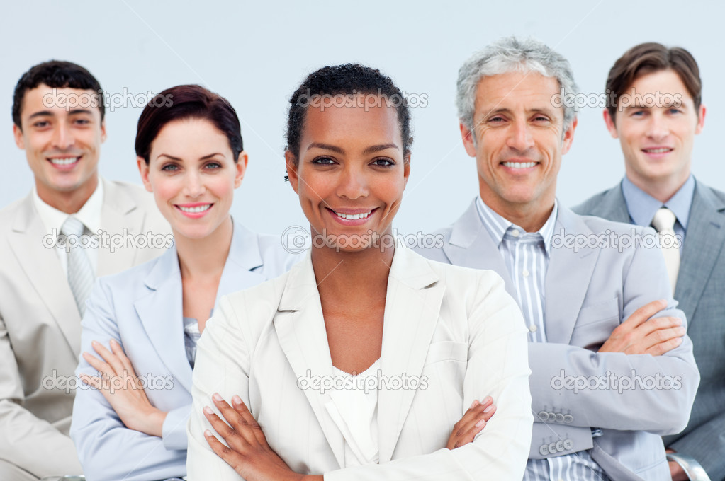 Diverse business standing with folded arms smiling at the camera — Stock Photo #10291257