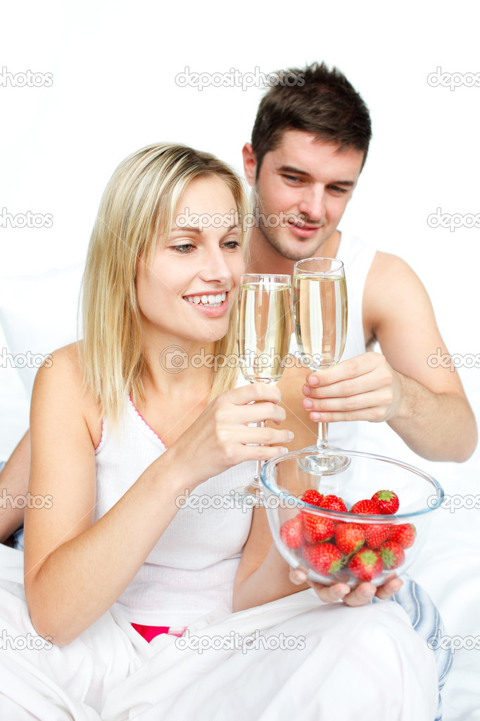 Couple toasting with champagne to an engagement  in bed — Stock Photo #10292737
