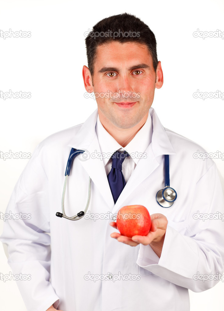 Young doctor holding a red apple  Stock Photo #10292799