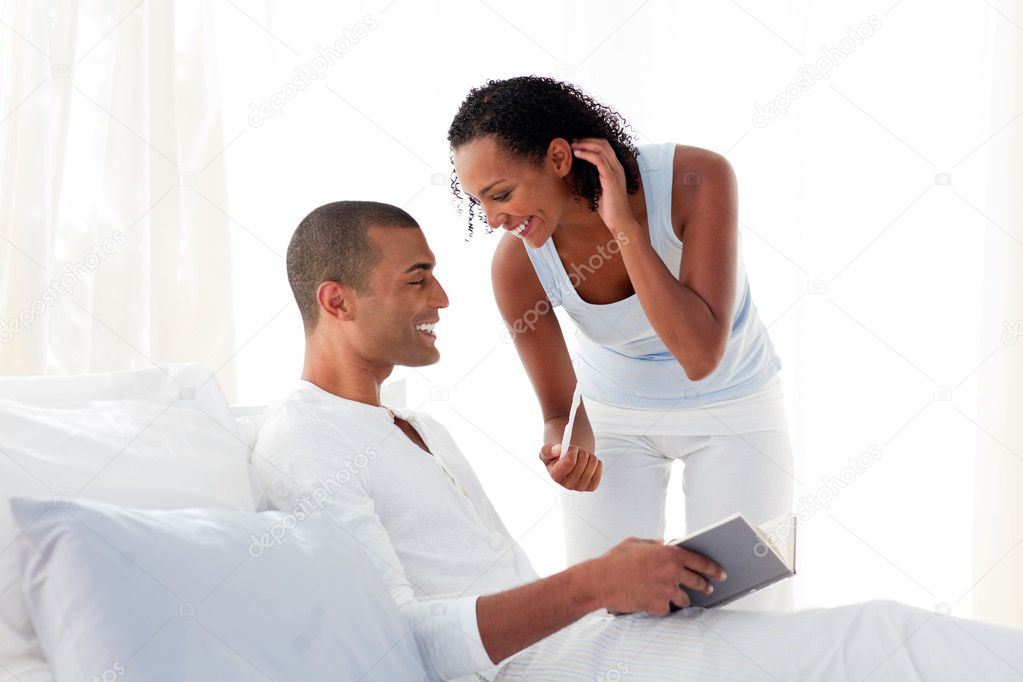 Cheerful couple finding out results of a pregnancy test at home  Stock Photo #10292931
