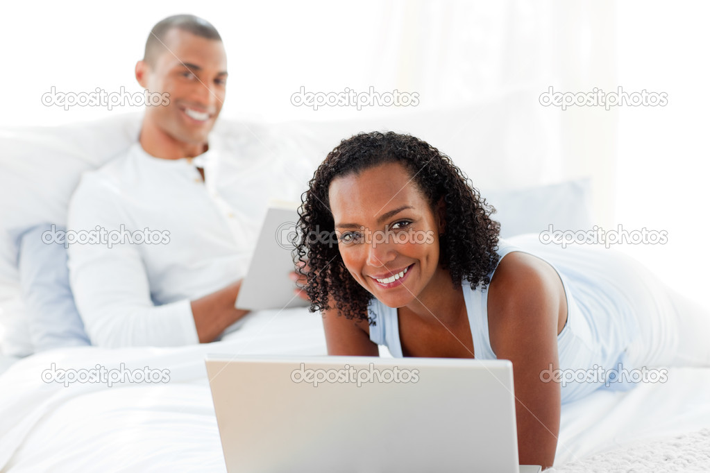 Happy couple relaxing on their bed at home — Stock Photo #10292948