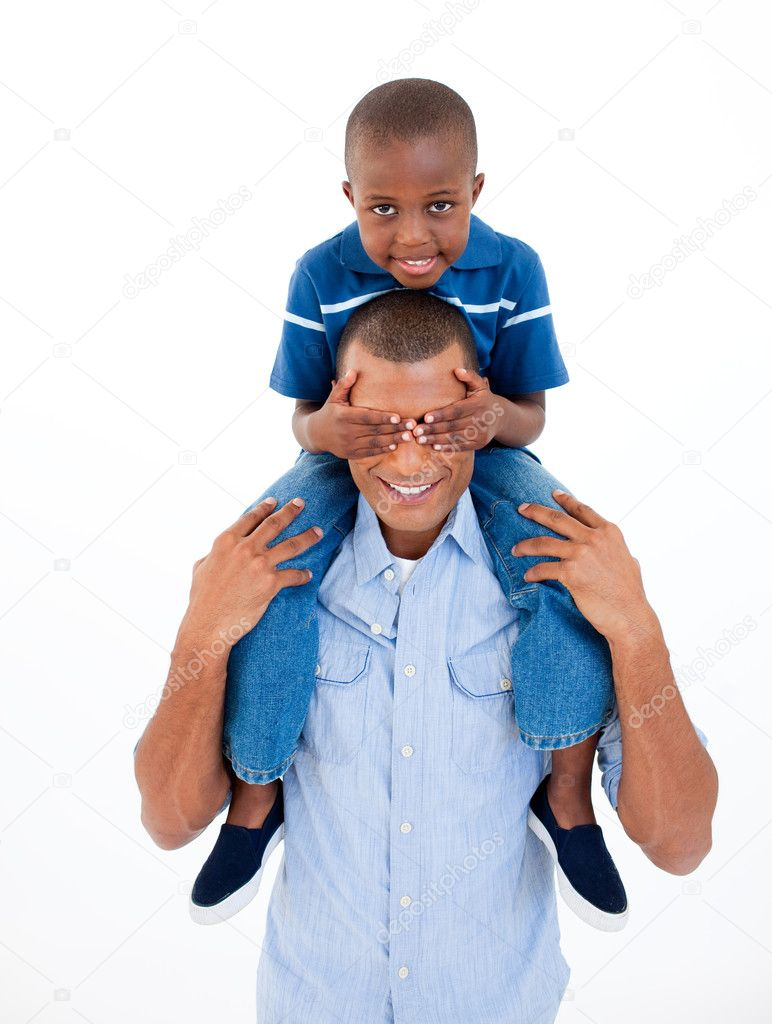 Smiling father giving his son piggiback ride — Stock Photo #10292975