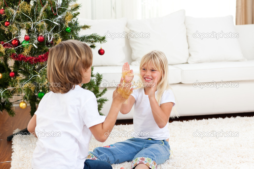 Cute siblings having fun at Christmas  at home — Stock Photo #10293483