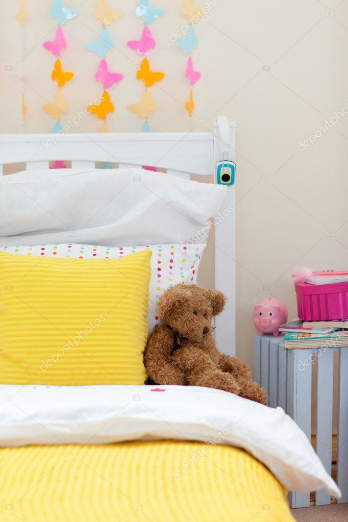 Close-up of child's bedroom with a teddy bear on the bed — Stock Photo #10293600
