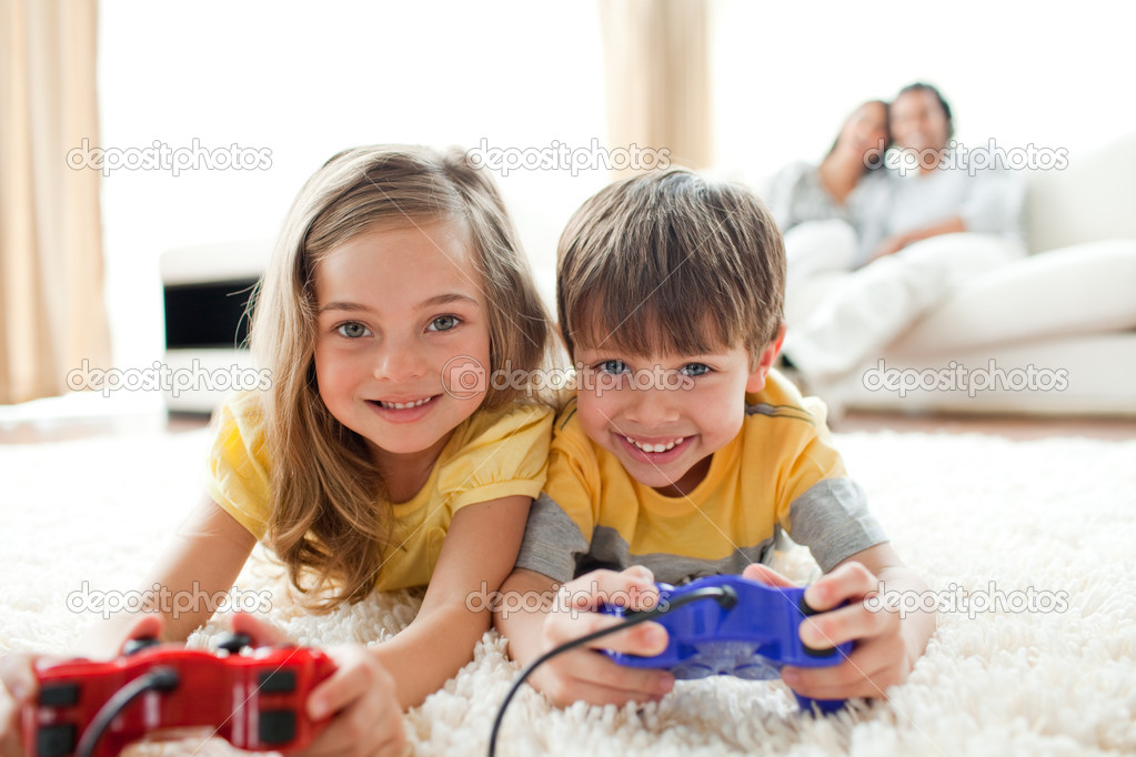 Loving siblings playing video game in the living room    #10293930