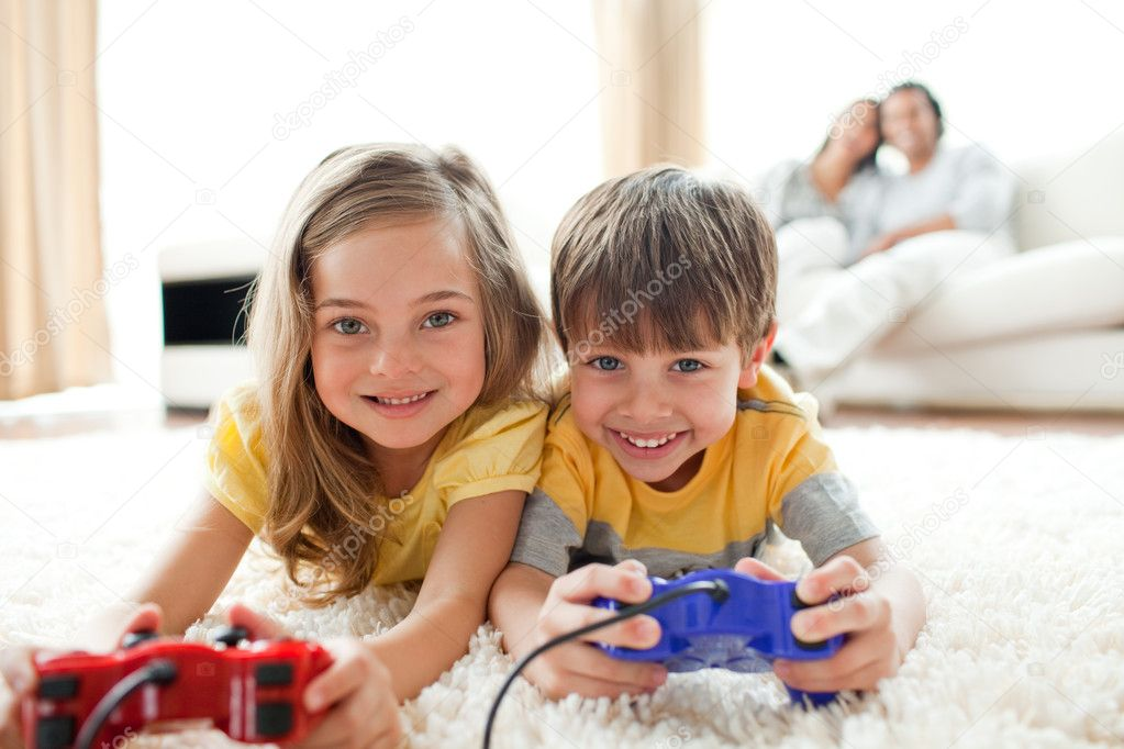Loving siblings playing video game in the living room — Photo #10293930