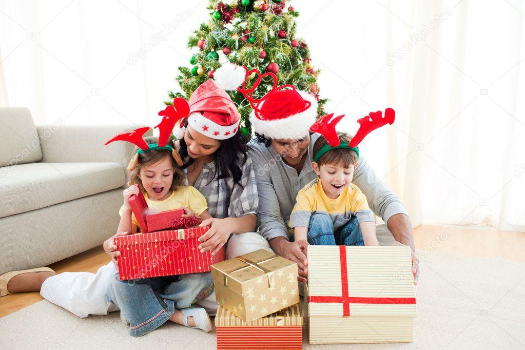 Happy family opening Christmas presents — Stock Photo ...