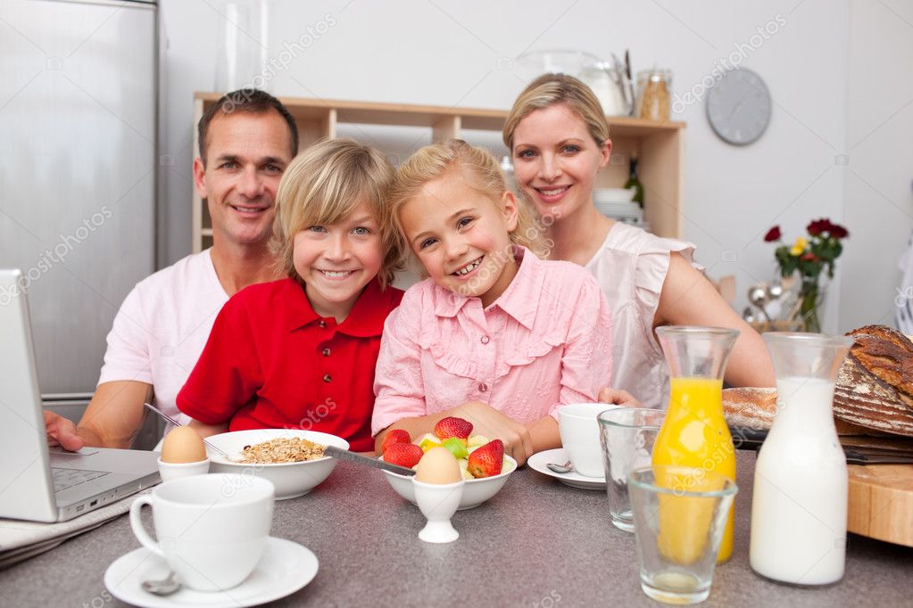 happy family having breakfast together  stock photo, Kitchen design