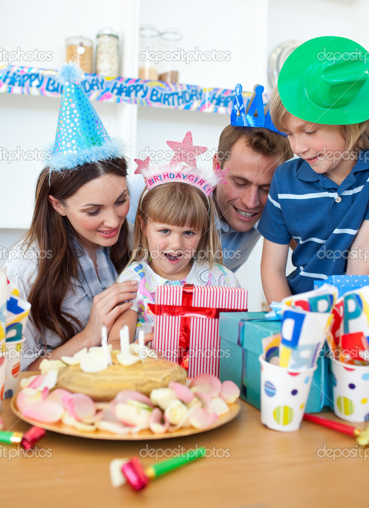Blond little girl celebrating her birthday in the kitchen — Stock Photo #10295139