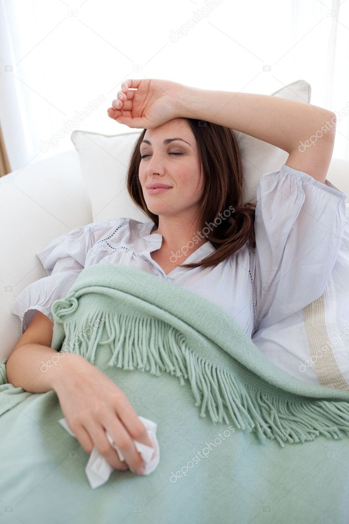 Young woman with the flu lying on the sofa — Stock Photo #10295210