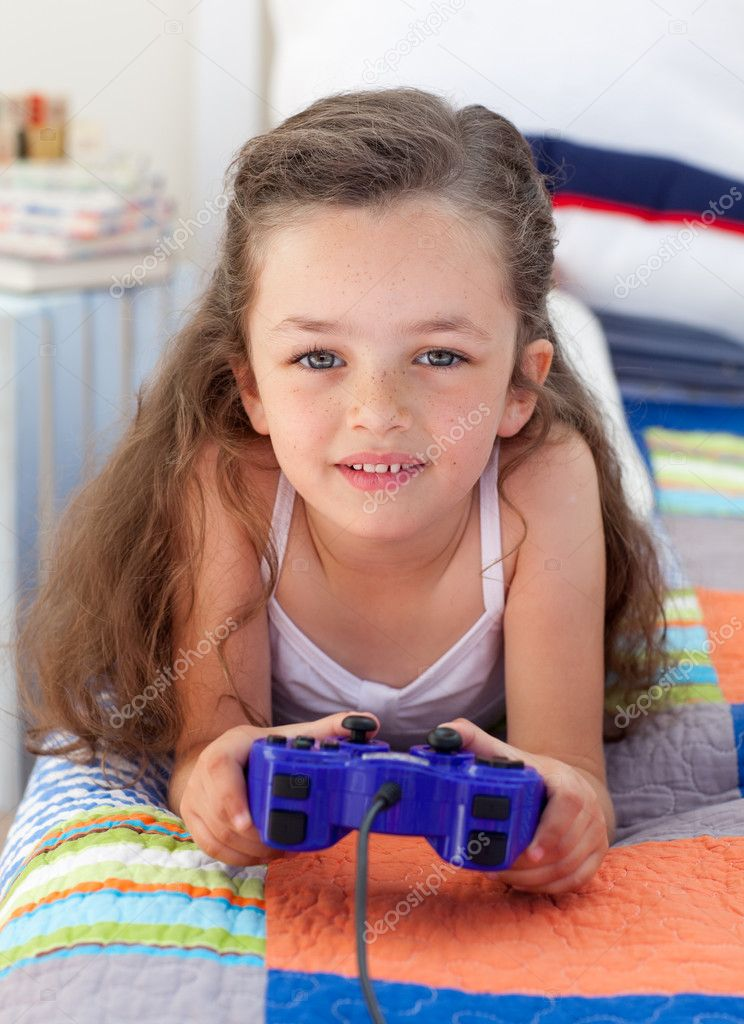 Little girl playing video games — Stock Photo ...