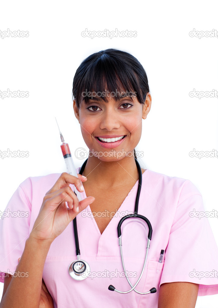 Portrait of a ethnic female doctor holding a syringe against a white background — Stock Photo #10295861