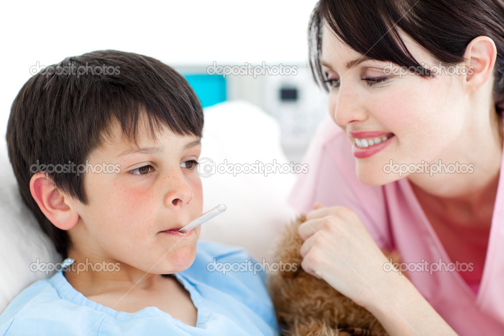 Smiling nurse taking her patient's temperature in a hospital — Stock Photo #10296038