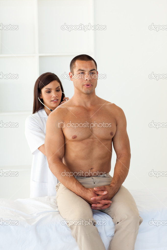 Female doctor examining a patient in the hospital — Stock Photo #10296251