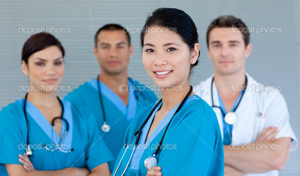 Multi-ethnic medical team smiling at the camera — Stock Photo #10296278