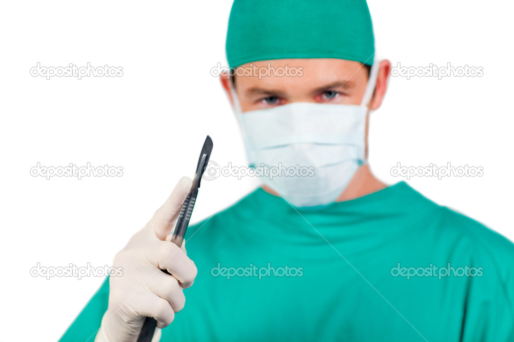 Concentrated surgeon holding a scalpel isolated on a white background  Stock Photo #10296656