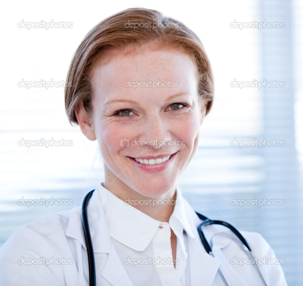 Portrait of a smiling female doctor in a hospital — Stock Photo #10296858