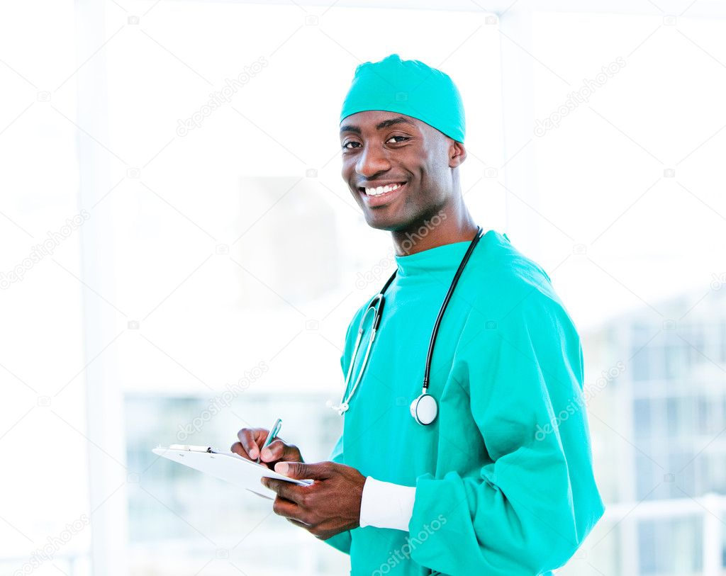 Attractive surgeon making notes in a patient's folder in a hospital — Stock Photo #10296884