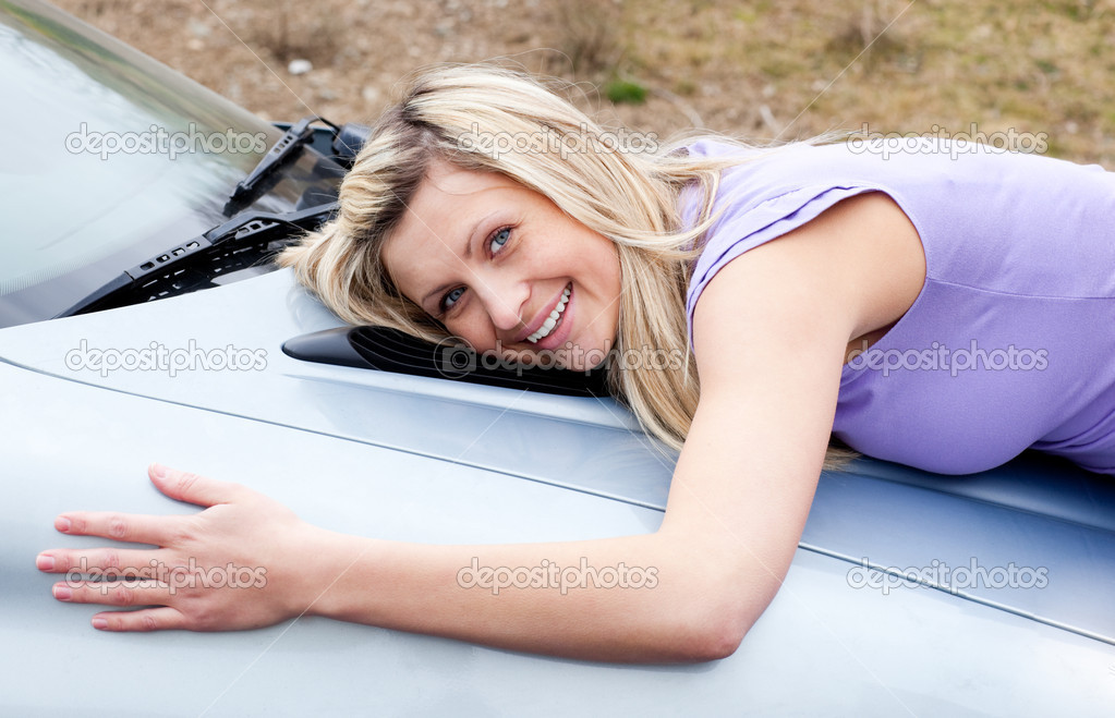 Jolly young female driver huging her new car — Stock Photo #10297144
