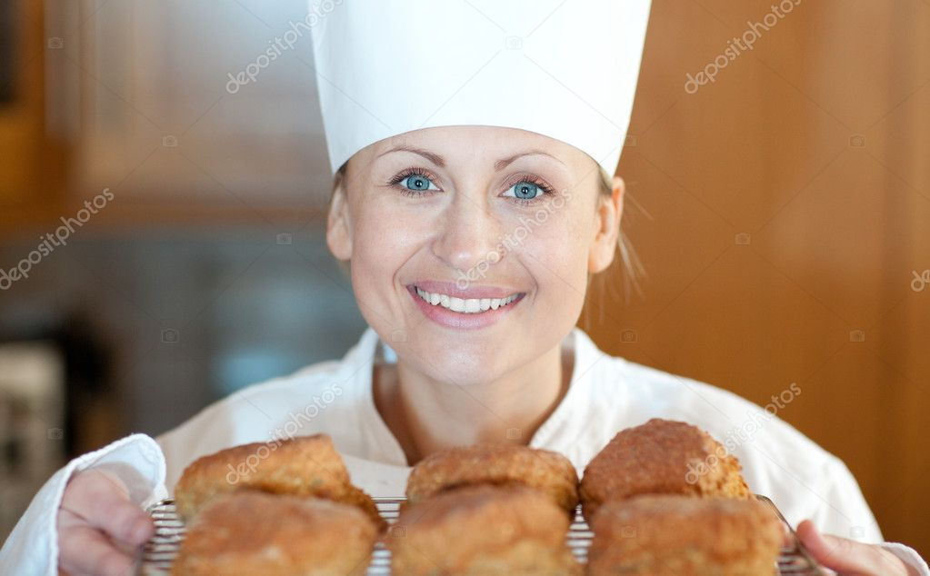 Close-up of a female chef baking scones in the kitchen — Stock Photo #10297175
