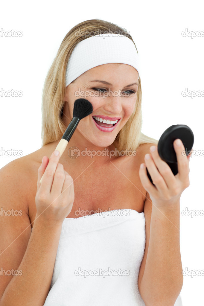 Blond woman putting on make-up against a white background — Stock Photo #10297456