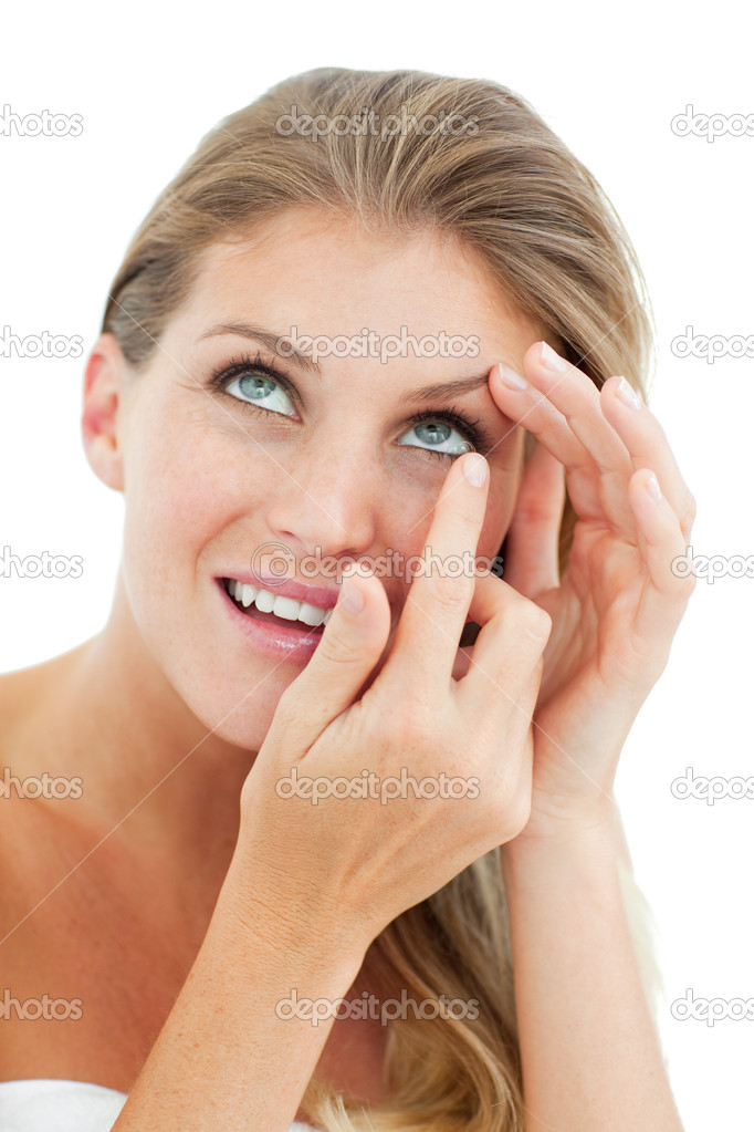 Attractive blond woman putting a contact lens isolated on a white background — Stock Photo #10297480