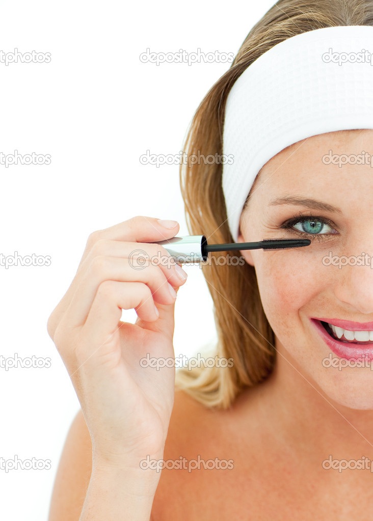 Young woman putting mascara against a white background — Stock Photo #10297547