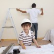 Little son drawing plans and father working — Stock Photo