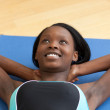 Happy woman in gym outfit excercising — Stock Photo