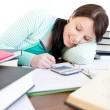 Attractive student doing her homework on a desk — Stock Photo #10300602