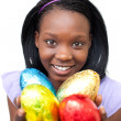 Attractive woman holding colorful Easter eggs - Stock Photo