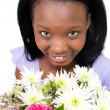 Attractive Afro-american woman holding flowers — Stock Photo