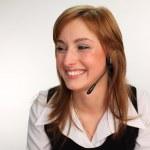 Woman on a Headset Talking — Stock Photo