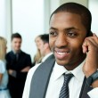 Stock Photo: Afro-American businessman on phone in office