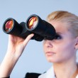 Serious business woman looking into Binoculars — Stock Photo