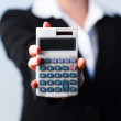 Business woman holding calculator — Stock Photo