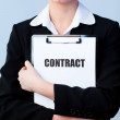 Woman holding a contract on a clipboard — Stock Photo