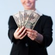 Business woman holding up dollars — Stock Photo #10301008