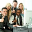 Young business team wth thumbs up in office — Stock Photo