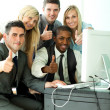 International business team wth thumbs up in office — Foto Stock