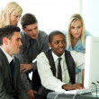 Ethnic business team working in office — Stock Photo
