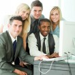 Smiling international business team working in office — Stock Photo